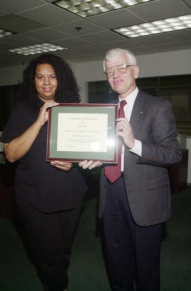 Lisa Carr - Employee of the Month - November 2001 - with President Alan Merten
