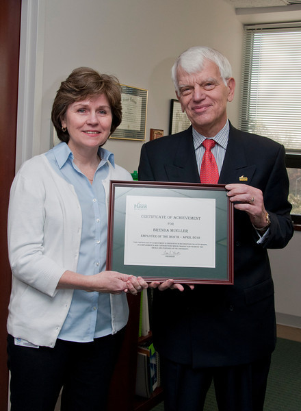 Dr. Alan Merten, President of George Mason University, presents Brenda Mueller, Director, OTS, College of Education & Human Development, with the employee of the month award, March 27, 2012 at Mason Hall, George Mason University.