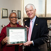 Employee of the Month Penny Smith with Dr. Alan Merten at a ceremony honoring her award in President Merten's office at Fairfax Campus.