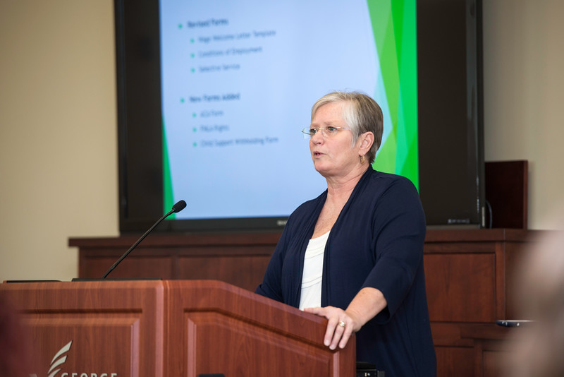 Helga Yunker speaks to faculty and staff, who are responsible for hiring non-benefitted employees, joining Equifax and staff from HR & Payroll for training on the new Electronic Onboarding process.  Photo by Ron Aira/Creative Services/George Mason University