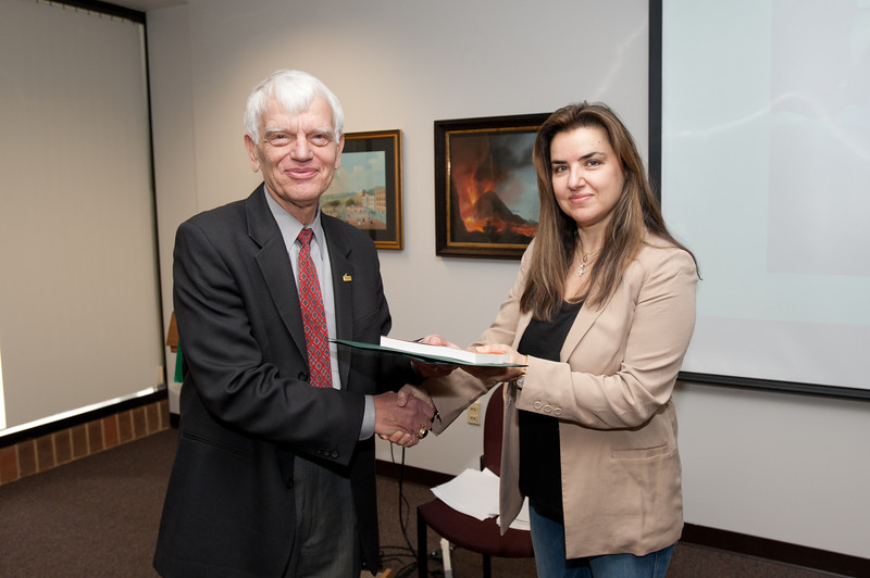 Peggy Agouris is presented with a certificate and book during the Legacy Leadership Spring 2012 Cohort closing ceremony with Dr. Alan Merten at Fairfax Campus. Photo by Alexis Glenn/Creative Services/George Mason University