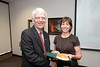 Beth Brock is presented with a certificate and book during the Legacy Leadership Spring 2012 Cohort closing ceremony with Dr. Alan Merten at Fairfax Campus. Photo by Alexis Glenn/Creative Services/George Mason University