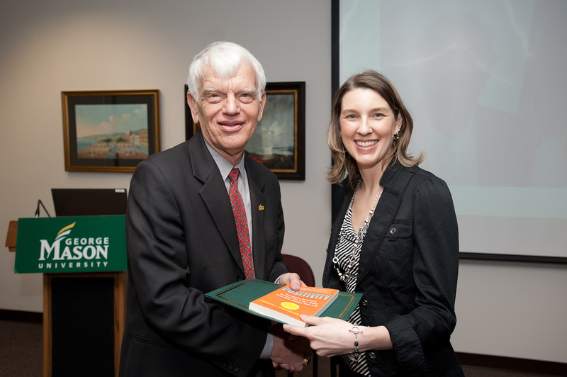 Traci Claar is presented with a certificate and book during the Legacy Leadership Spring 2012 Cohort closing ceremony with Dr. Alan Merten at Fairfax Campus. Photo by Alexis Glenn/Creative Services/George Mason University