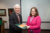 Terri Mancini is presented with a certificate and book during the Legacy Leadership Spring 2012 Cohort closing ceremony with Dr. Alan Merten at Fairfax Campus. Photo by Alexis Glenn/Creative Services/George Mason University