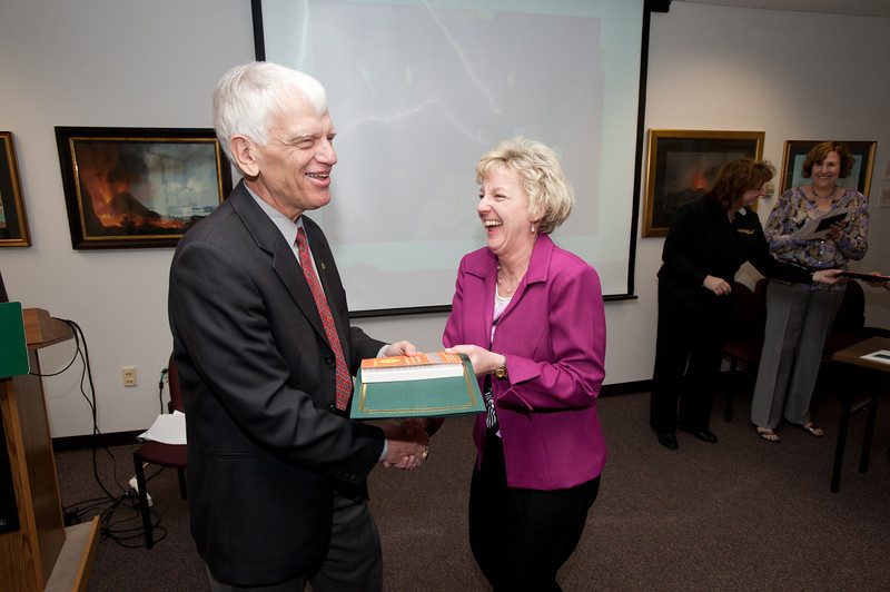 Sharron Cullen is presented with a certificate and book during the Legacy Leadership Spring 2012 Cohort closing ceremony with Dr. Alan Merten at Fairfax Campus. Photo by Alexis Glenn/Creative Services/George Mason University