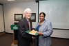 Mariama Boney is presented with a certificate and book during the Legacy Leadership Spring 2012 Cohort closing ceremony with Dr. Alan Merten at Fairfax Campus. Photo by Alexis Glenn/Creative Services/George Mason University