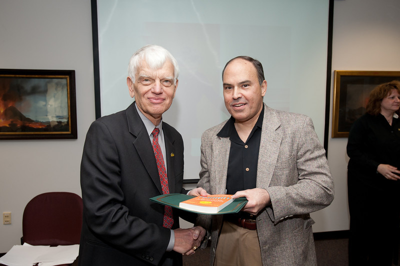Gregg Toney is presented with a certificate and book during the Legacy Leadership Spring 2012 Cohort closing ceremony with Dr. Alan Merten at Fairfax Campus. Photo by Alexis Glenn/Creative Services/George Mason University