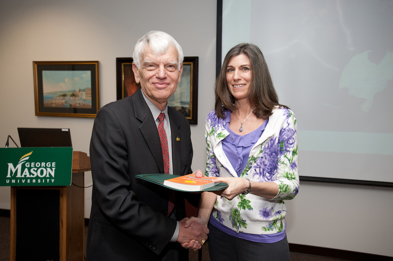 Christine Clark-Talley is presented with a certificate and book during the Legacy Leadership Spring 2012 Cohort closing ceremony with Dr. Alan Merten at Fairfax Campus. Photo by Alexis Glenn/Creative Services/George Mason University