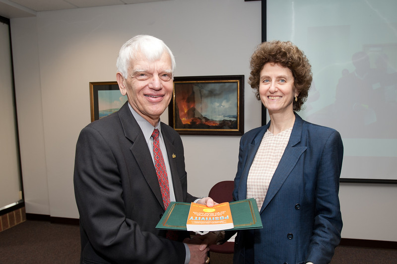 (Avram) Kim Blackwell is presented with a certificate and book during the Legacy Leadership Spring 2012 Cohort closing ceremony with Dr. Alan Merten at Fairfax Campus. Photo by Alexis Glenn/Creative Services/George Mason University