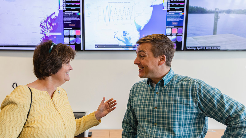George Mason University President Anne Holton talks with professor Celso Perreira during a visit to the Potomac Science Center. Photo by Lathan Goumas/Office of Communications and Marketing <br /> <br /> Photo Taken:Tuesday, October 29, 2019