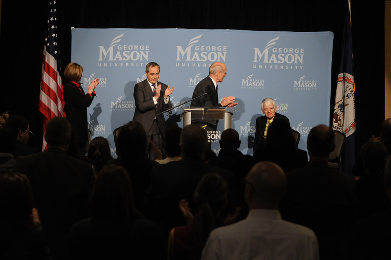 111215325 - (on stage L-R) Lovey L. Hammel; Angel Cabrera, President-Elect of George Mason University; and Ernst Volgenau congratulate Alan Merten, President of George Mason University on years of service after announcing Merten's successor on December 15, 2011 at the Mason Inn at Fairfax Campus. Photo by Evan Cantwell/Creative Services/George Mason University