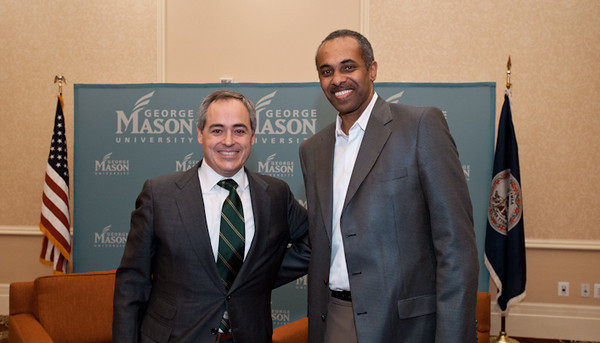 111215511s Paul Hewitt, George Mason University men's basketball coach, stands next to Dr. Angel Cabrera, President-Elect of George Mason University, after Cabrera was announced as the next president of the University on December 15, 2011 at the Mason Inn at Fairfax Campus. Photo by Alexis Glenn/Creative Services/George Mason University