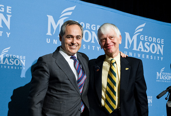 111215510s - Mason leaders, present and future: Mason President Alan Merten, right, welcomes Dr. Ángel Cabrera, who will become Mason's sixth president on July 1, 2012. Photo by Alexis Glenn/Creative Services/George Mason University