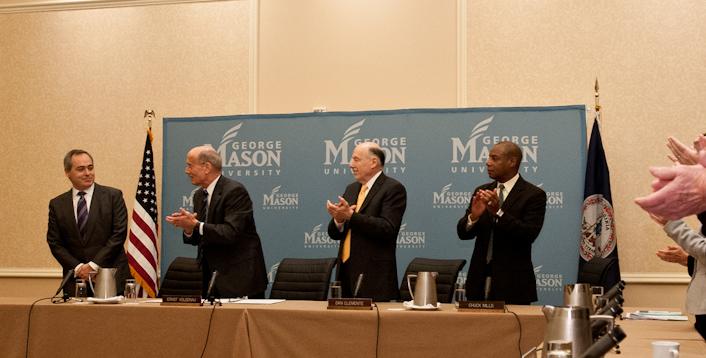 111215514s - Mason's Board of Visitors applauds as Dr. Ángel Cabrera, far left, is announced as the board's unanimous selection to be the university's next president. Photo by Alexis Glenn/Creative Services/George Mason University