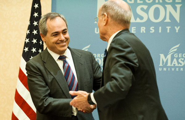 111215501s Dr. Angel Cabrera, President-Elect of George Mason University, shakes hands with Dr. Ernst Volgenau after Cabrera was announced as Mason's next president, on December 15, 2011 at the Mason Inn at Fairfax Campus. Photo by Alexis Glenn/Creative Services/George Mason University