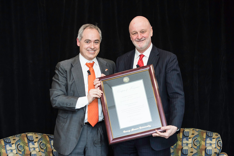 President Angél Cabrera presents a H.E. The Ambassador of Spain, Ramón Gil-Casares with a Certificate of Recognition  during the Freedom and Learning Forum on April 5.  Photo by Ron Aira/Creative Services/George Mason University