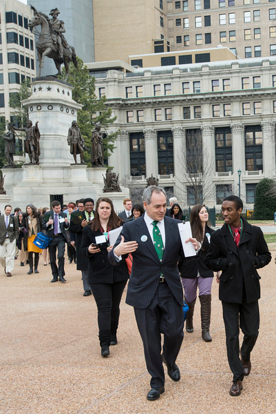 President Ángel Cabrera walks with students at the Virginia State Capitol at Mason Lobby Day in Richmond. Photo by Alexis Glenn/Creative Services/George Mason University