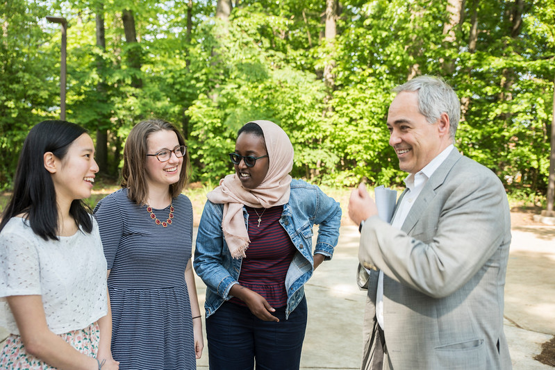 Khue-Tu Nguyen, Beverly Harp, and Asha Athman, posing here with President Cabrera, landed prestigious scholarships that will carry them overseas to further study a language while serving as American cultural ambassadors.  Photo by:  Ron Aira/Creative Services/George Mason University