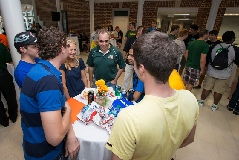 President Ángel Cabrera greets students at the New Student BBQ at the City of Fairfax City Hall during Welcome Week. Photo by Alexis Glenn/Creative Services/George Mason University