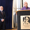 """Legendary basketball coach Richard """"Doc"""" Sauers, honored for 61 years of UAlbany service, addresses the crowd. Interim President Stellar looks on."""
