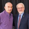 """Legendary basketball coach Richard """"Doc"""" Sauers, honored for 61 years of UAlbany service, with Interim President James Stellar."""