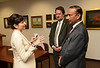 (Left to right) Sara de Freitas, director of research at SGI Conventry speaking with Scott Martin and M. Siddique Sheikh, GMU Board of Visitors during the MOU signing ceremony with SGI Conventry.