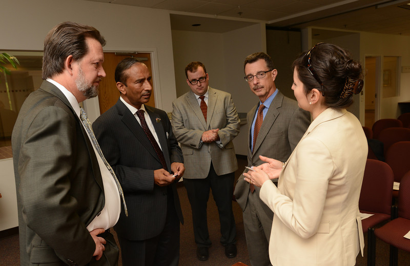 Sara de Freitas (beige jacket), director of research at SGI Conventry speaking with M. Siddique Sheikh, GMU Board of Visitors, and Scott Martin (far left) during the MOU signing ceremony with SGI Conventry. Photo by Evan Cantwell/Creative Services/George Mason University