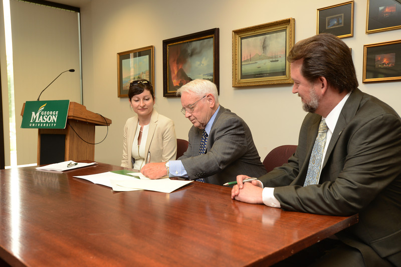 (Left to right) Sara de Freitas, director of research at SGI Conventry; Provost Peter Stearns; and Scott Martin attending the Memorandum of Understanding signing ceremony. Photo by Evan Cantwell/Creative Services/George Mason University