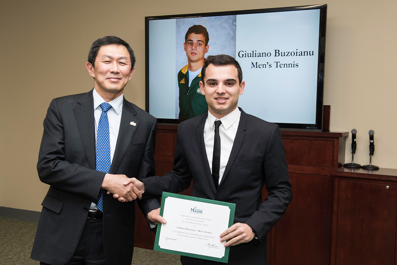 Giuliano Buzoianu. Dr. David Wu presents the 2016 Peter N. Stearns Provost Scholar Athlete Awards.  Photo by Ron Aira/Creative Services/George Mason University