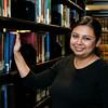 Mason graduate student Arpita Nepal in the Arlington Campus Library in Founders Hall. Photo by Alexis Glenn/Creative Services/George Mason University