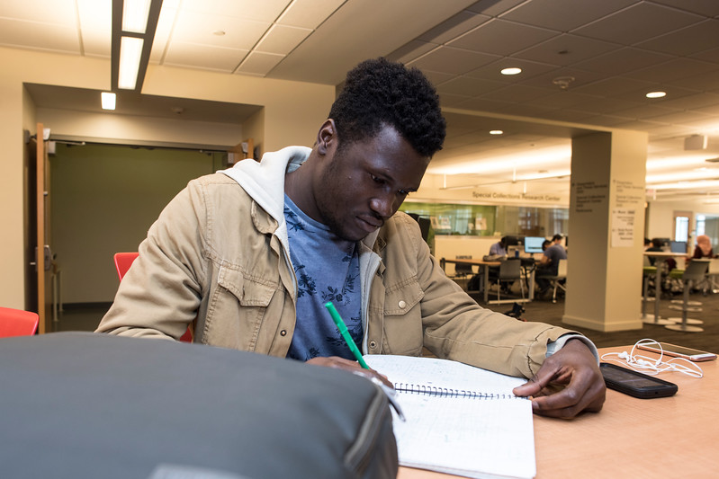 A George Mason student studying at Fenwick Library. Photo by: Bethany Camp / Creative Services / George Mason University