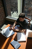 CHSS student studying in the Fenwick Library. Photo by Creative Services/George Mason University