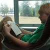 A student reads a book at Mercer Library at Prince William Campus.  Photo by Creative Services/George Mason University