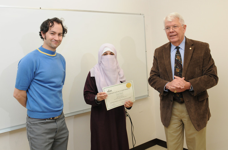 (Left to right): Thomas Kozumplik, Core Instructor; Sarah Alsharif is awarded student of the month for outstanding acheivement in CORE; and John Pope, Executive Director, English Language Institute.