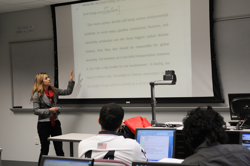 Instructor Ghania Zgheib teaching English Language Institute students in the classroom. Photo by Evan Cantwell/Creative Services/George Mason University