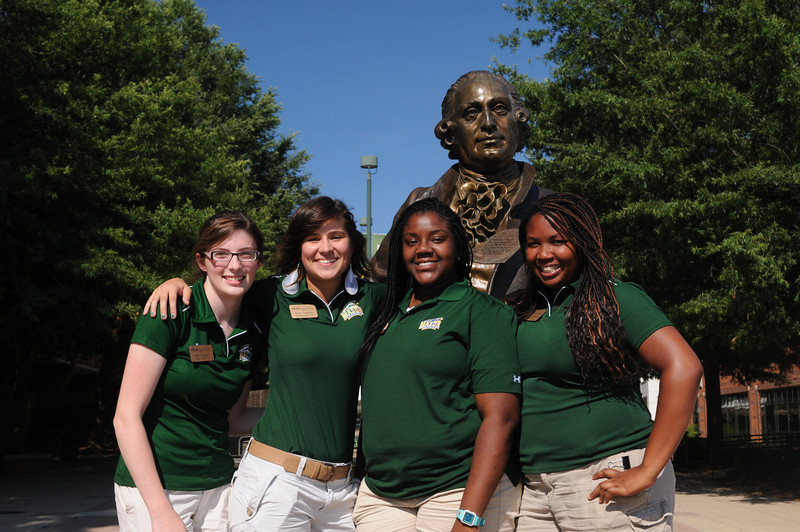 OFPS staff group photos at the Mason Statue.