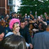 A Mason Police officer and security escort Miley Cyrus on Campus.  Photo by Evan Cantwell/Creative Services/George Mason University