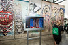 An attendee of the Washington Journalism and Media Conference checks out the Berlin Wall exhibit at the Newseum in Washington, DC.  Photo by Ron Aira/Creative Services/George Mason University