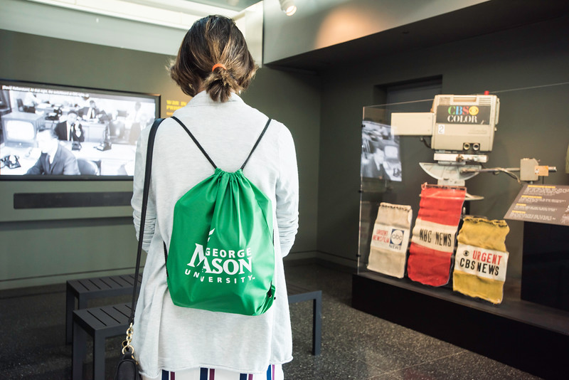 An attendee of the Washington Journalism and Media Conference peruse the Newseum in Washington, DC.  Photo by Ron Aira/Creative Services/George Mason University