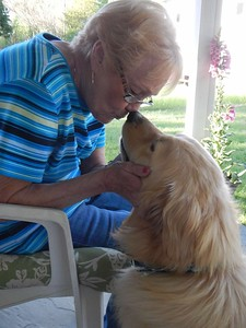 dog kiss older woman