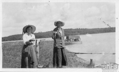 [Two women holding fish at Kenosee Lake]