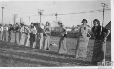 [Central Collegiate girls preparing for a potato sack race]