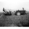 Henry Murton cutting with tractor and binder 1940s