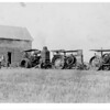 [Three tractors pulling a house, south of Arcola, 1918]