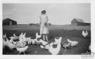 [Florence Bekker feeding the chickens on the family farm in Gravelbourg]