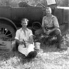 [Jack Purdy and George Smith having a beer after berry picking, Moose Mountains, 1930s]