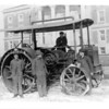 [Four young men around a tractor, Winnipeg, 1900s]
