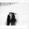 [Mrs. Ketchum outside her kitchen door, outside Arcola, February 6, 1947]