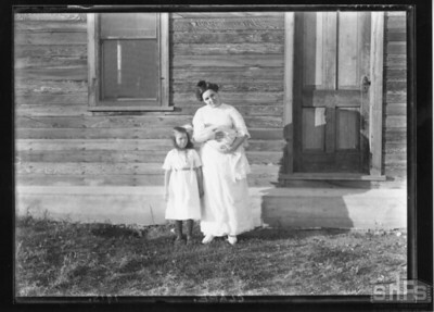 [Mrs. Pittman holding Gertrude, with Gene beside her]