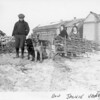[Dogs hauling branches, Welwyn, 1930s]